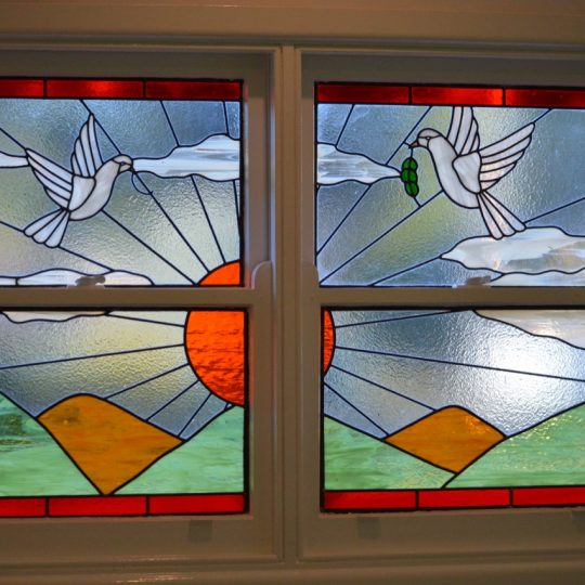 Leadlight of Two doves at animal hospital